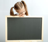 Girl and clear blackboard Royalty Free Stock Photos