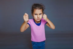 Girl clenched her fists Royalty Free Stock Photos