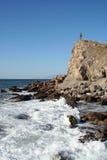 Girl on a cliff Stock Photos