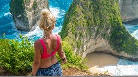 Girl on Cliff at Manta Bay or Kelingking Beach, Nusa Penida Island, Bali, Indonesia Stock Photography