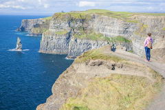Girl at the Cliff of Moher Royalty Free Stock Images
