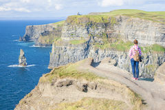 Girl at the Cliff of Moher Royalty Free Stock Photography