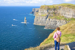 Girl at the Cliff of Moher Royalty Free Stock Photo