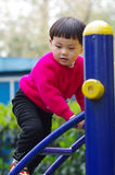 Girl climb ladder. A chinese cliambing the ladder Stock Image