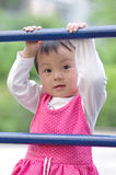 Girl climbing. A chinese cliambing the ladder Stock Photo