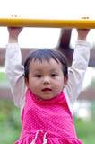 Girl climbing Royalty Free Stock Photo