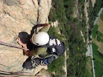 Girl climbing Stock Images