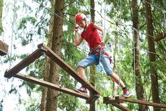 Girl at climbing activity in high wire forest park Stock Image