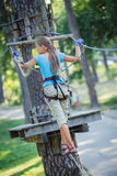 Girl in a climbing adventure park Royalty Free Stock Images
