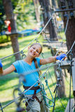 Girl in a climbing adventure park Stock Image