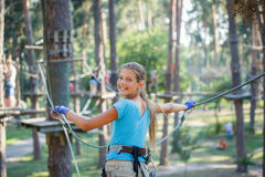 Girl in a climbing adventure park stock photography