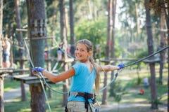 Girl in a climbing adventure park Stock Photography