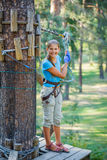 Girl in a climbing adventure park Royalty Free Stock Photo