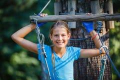 Girl in a climbing adventure park Stock Image
