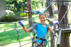 Girl in a climbing adventure park Stock Images