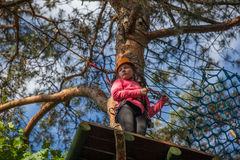 Girl climbing in adventure park , rope park Royalty Free Stock Images