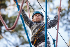 Girl climbing in adventure park , rope park Stock Photo