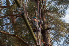 Girl climbing in adventure park , rope park Stock Image