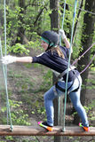 Girl climbing at adventure park Stock Photos