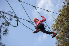 Girl climbing in adventure park Royalty Free Stock Images