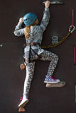 Girl climbing in adventure park Royalty Free Stock Photo