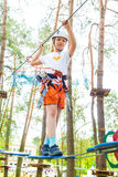 Girl Climbing in Adventure Park Royalty Free Stock Image