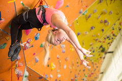 Girl with climbing equipment hanging on a rope Stock Image