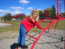 Girl on climbing frame royalty free stock image