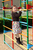 Girl on a climbing frame Royalty Free Stock Photography