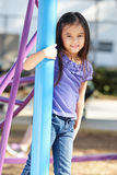 Girl On Climbing Frame In Park Royalty Free Stock Images
