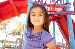 Girl On Climbing Frame In Park Stock Photo