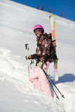 Girl climbing for a freeride. Girl with skis climbing for a freeride Royalty Free Stock Photo