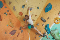 Girl climbing in gym Royalty Free Stock Photography