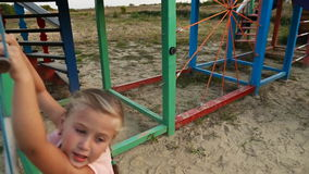 Girl climbing on the hill stock footage