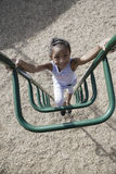 Girl Climbing Jungle Gym Stock Photo