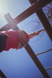 Girl climbing monkey bars during obstacle course training Royalty Free Stock Photography