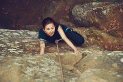 Girl climbing outdoor Royalty Free Stock Photography