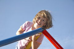 Girl on climbing pole 04 Stock Photos