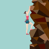 Girl  is climbing on a rock Royalty Free Stock Image