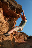 Girl climbing at rock at outdoor. Photo from back side #3 Royalty Free Stock Photography