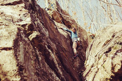Girl climbing rock outdoor Royalty Free Stock Photo