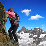 Girl climbing on the rock. In Pennine Alps, Switzerland stock photo