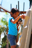 Girl climbing rock wall Stock Photography