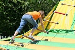 Girl Climbing Rope Ladder Stock Photo