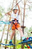 Girl Climbing in Rope Park Stock Image