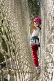 Girl Climbing in Rope Park Royalty Free Stock Images