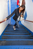 Girl climbing the stairs of a ferry. Smiling girl climbing the blue stairs of a ferry Stock Photo