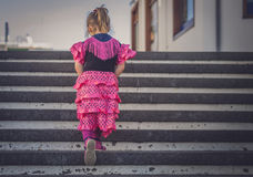 Girl climbing stairs Royalty Free Stock Photo