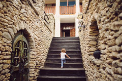 Girl Climbing on Stairs Royalty Free Stock Photos
