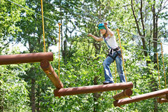 Girl is climbing to high rope structures Stock Image